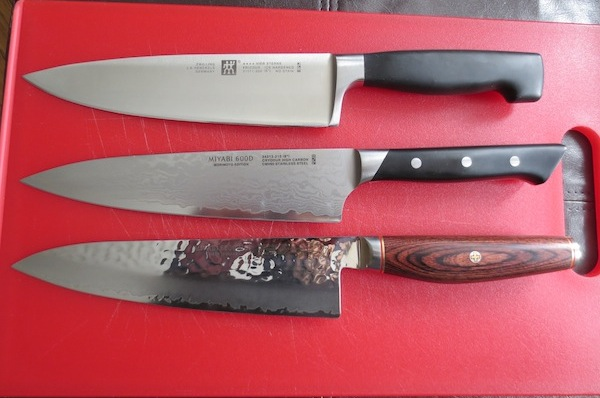Quick comparison to other 8-inch knives: Top: Zwilling 4-Star chef's Mid: Miyabi Fusion gyuto Bottom: Miyabi Artisan gyuto